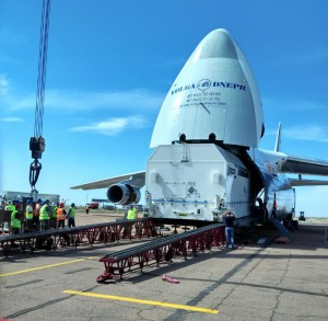Offloading the AsiaSat 9 container from a transport aircraft at the Baikonur airport Photo courtesy of ILS